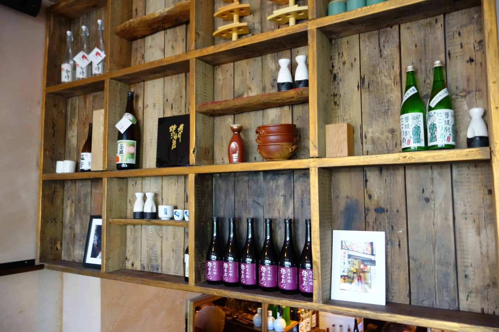 wooden shelves with bottles on
