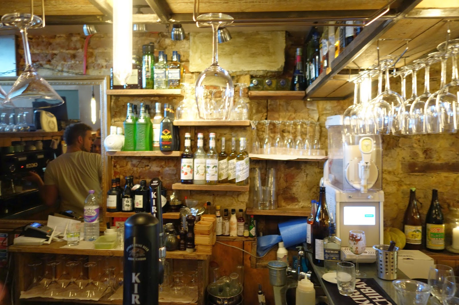 behind the bar; bottles and glasses