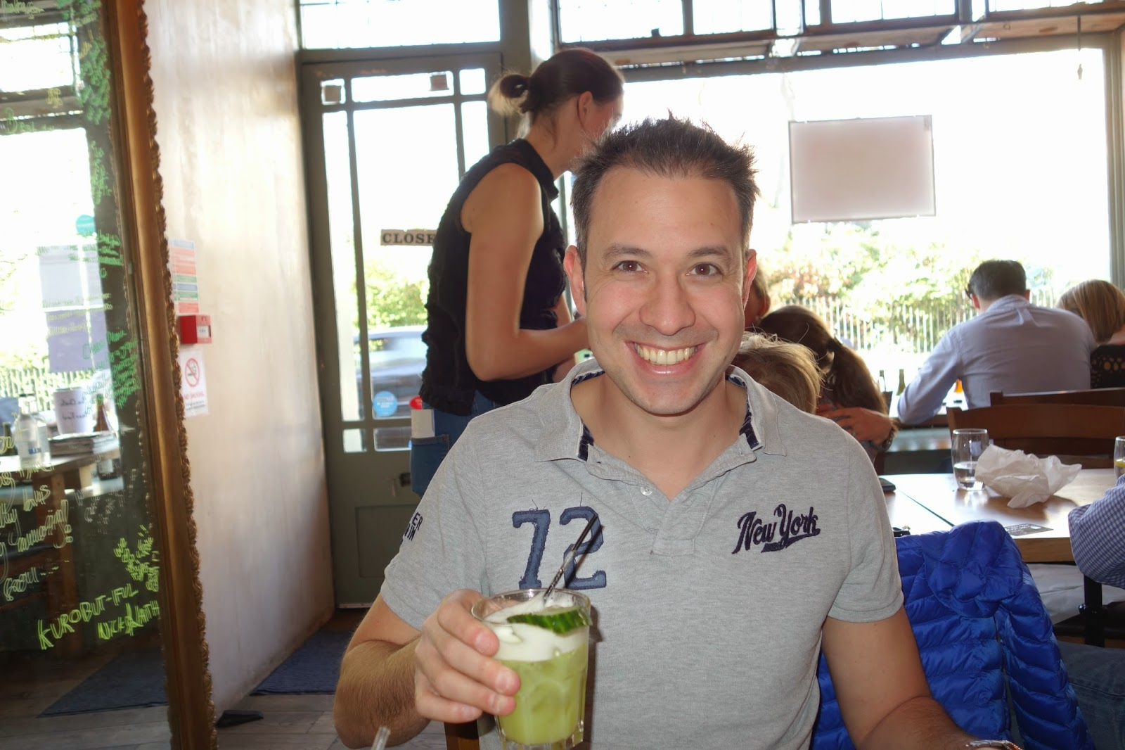 Man holds green drink