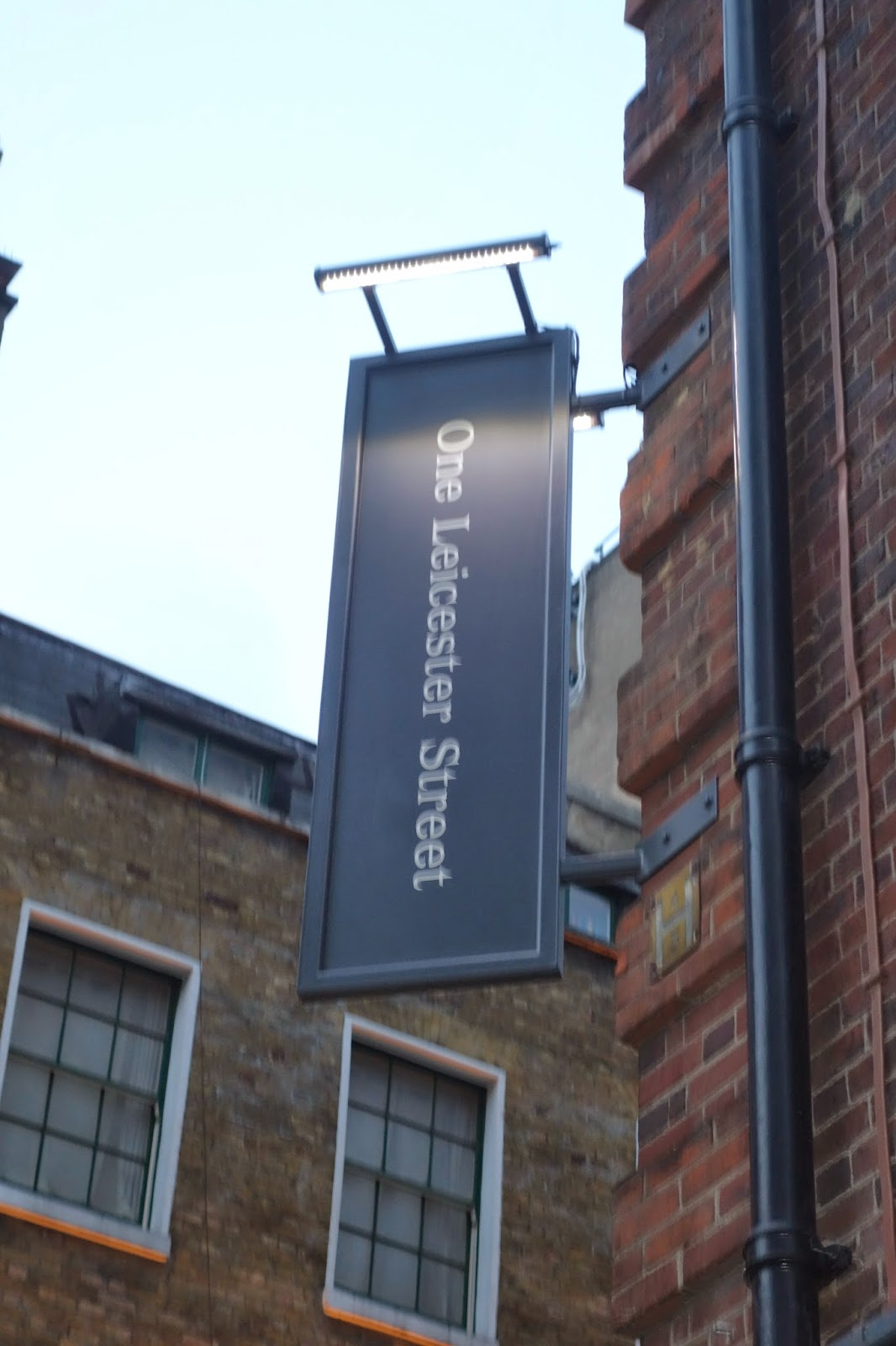 One Leicester street sign