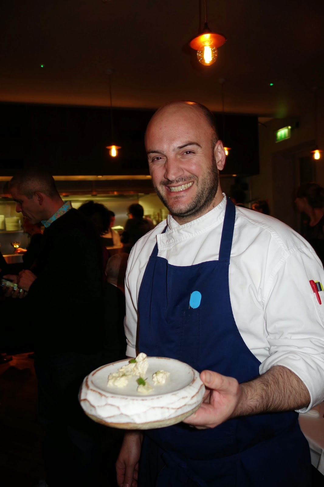 Chef holding trout meringues