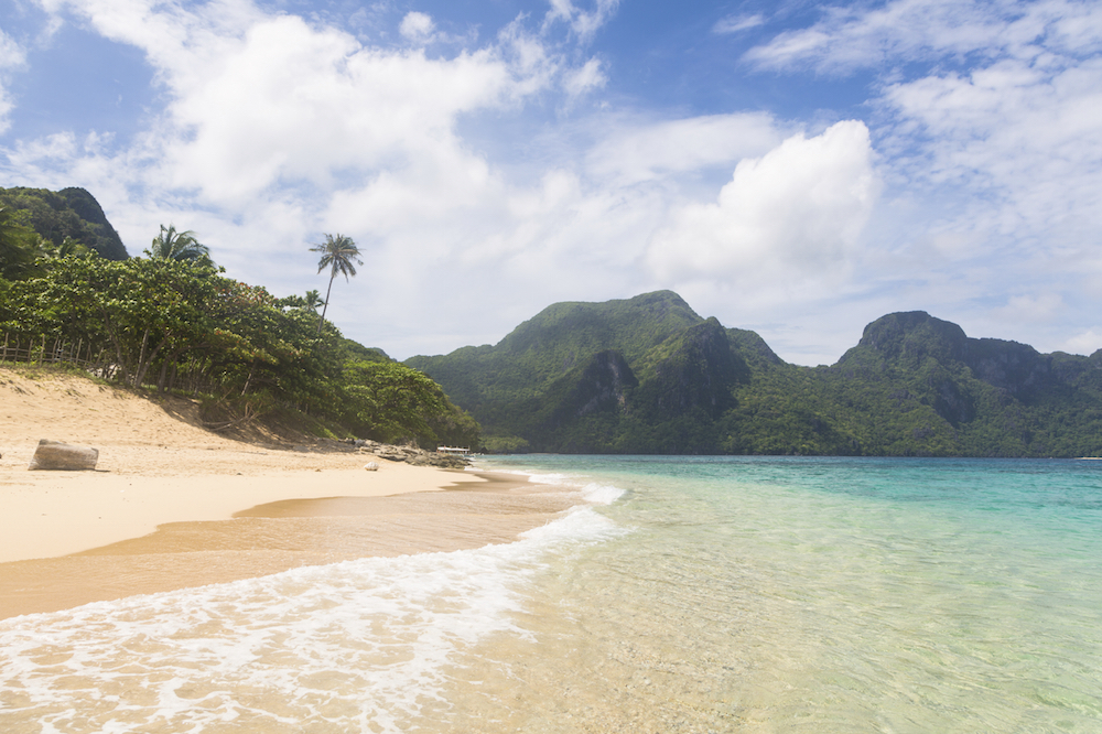 """Stunning beach on """"Helicopter island"""" in the Bacuit archipelago in El Nido, Palawan, Philippines"""